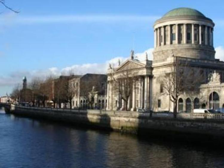 Kildare detective garda wins High Court                         dismissal case